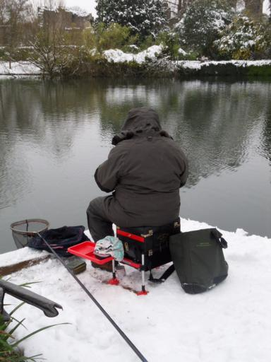 Steve fishing in the snow